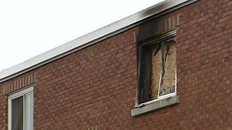 A window is boarded up after an OC Transpo driver rescued three people from a fire at an apartment building, Thursday, Dec. 9, 2010.