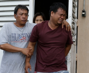 Edmund De Vera, cries after viewing the body of his son John-John, 5, inside a morgue of a private hospital in Kawit township, Cavite province 16 kilometres south of Manila, Philippines, Friday, Jan. 4, 2013. (AP / Bullit Marquez)