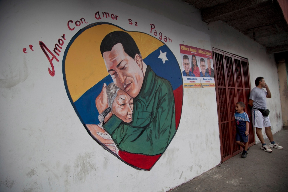 A heart-shaped mural shows an image of Venezuela's President Hugo Chavez hugging a woman, in Caracas, Venezuela, Friday, Jan. 4, 2013. (AP / Ariana Cubillos)