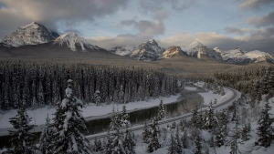 The morning light is seen on the mountains surrounding the Bow River in Lake Louise, Alta. Wednesday, November 28, 2012. (Jonathan Hayward / THE CANADIAN PRESS)