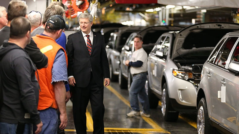 Prime Minister Stephen Harper greets autoworkers at Ford Motor plant in Oakville Ont. on Friday, Jan. 4, 2013. (Chris Young / THE CANADIAN PRESS)