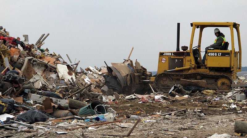 A worker uses a bulldozer to push debris from Superstorm Sandy into a large pile in Lavallette N.J., Friday, Jan. 4, 2012. (AP / Wayne Parry)
