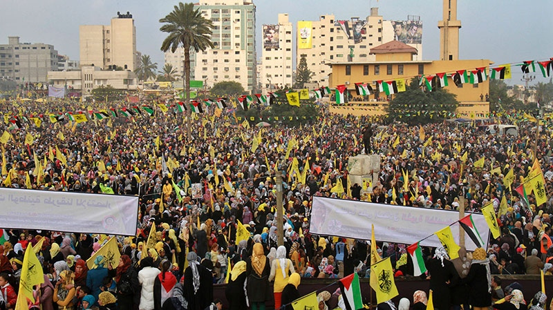 Palestinians hold yellow Fatah flags during celebrations marking the 48th anniversary of the Fatah movement in Gaza City, Friday, Jan. 4, 2013. (AP / Adel Hana)