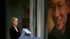 The image of Chinese dissident Liu Xiaobo is seen in the background at the Nobel Peace Prize ceremony in Oslo, Norway, Friday, Dec. 10, 2010.