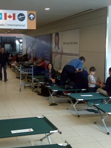 Passengers wait at the Ottawa airport on cots provided by the Canadian Red Cross (Paul Delannoy, meteorologist).