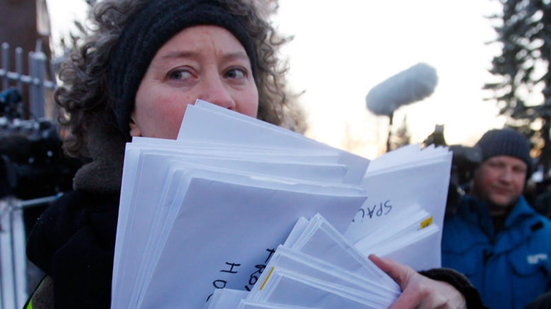 A representative of Amnesty International holds petitions signed by 100,000 people around the world to demand the freedom of Nobel peace laureate Liu Xiaobo Thursday Dec. 9, 2010 outside te Chinese Embassy in Oslo, Norway. (AP / John McConnico)