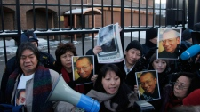Protestors shout for the freedom of Nobel peace laureate Liu Xiaobo Thursday Dec. 9, 2010 outside the Chinese Embassy in Oslo, Norway. (AP / John McConnico)