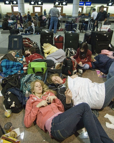 Students from Ottawa wait out flight delays at Pierre Elliott Trudeau Airport in Montreal, Sunday, March 9, 2008. (Peter McCabe/ THE CANADIAN PRESS)