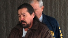 In this Dec. 7, 2007, file photo John Graham arrives at the federal courthouse in Rapid City, S.D. Graham, a Southern Tutchone Indian from Canada and former AIM member, heads to trial on first-degree murder charges Wednesday Dec. 1, 2010 in South Dakota. (AP / Carson Walker)
