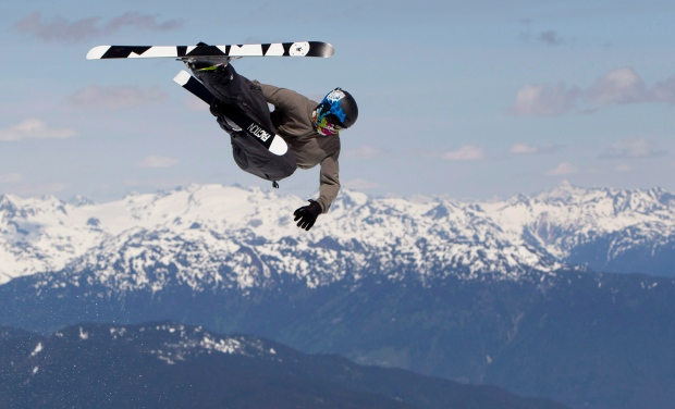A Canadian halfpipe team member takes to the air as he trains on the Blackcomb glacier in Whistler, B.C. Friday, July, 6, 2012. (Jonathan Hayward / THE CANADIAN PRESS)