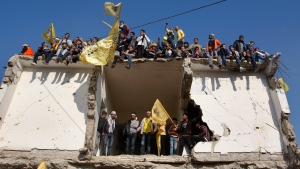 Palestinians hold Fatah yellow flags during celebrations marking the 48th anniversary of the Fatah movement in Gaza City, Friday, Jan. 4, 2013. (AP / Hatem Moussa)