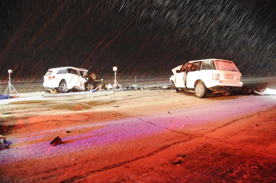 This RCMP handout photo shows damaged vehicles after a crash near Red Deer and Innisfail on March 4, 2012, that killed four foreign workers from the Philippines. (THE CANADIAN PRESS / HO-RCMP)