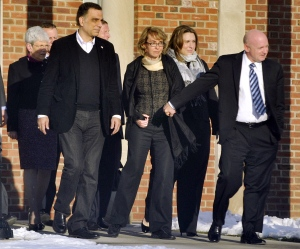 Former U.S. Rep. Gabrielle Giffords, centre, holds hands with her husband, Mark Kelly, while exiting Town Hall at Fairfield Hills Campus in Newtown, Conn., Friday, Jan. 4, 2013. (The News-Times, Jason Rearick)
