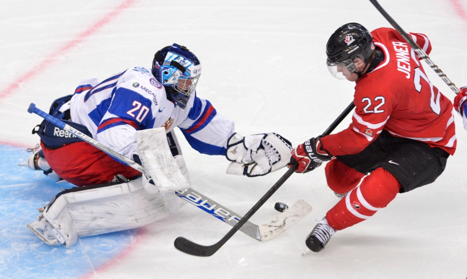 Russia goaltender Andrei Makarov makes a save off Team Canada's Boone Jenner during third period bronze medal hockey action at the IIHF World Junior Championships in Ufa, Russia, on Saturday, Jan. 5, 2013. (Nathan Denette / THE CANADIAN PRESS)