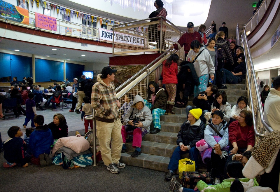 People gather at Sitka High School in Sitka, Alaska, early Saturday, Jan. 5, 2013. (Daily Sitka Sentinel, James Poulson)