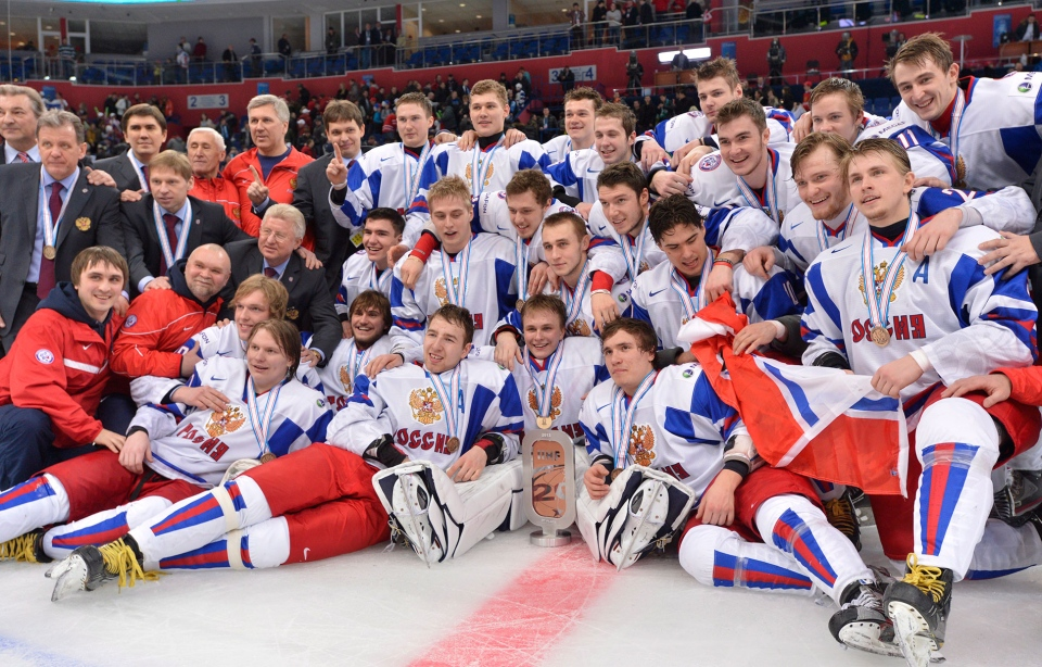Members of Team Russia pose for a photograph during victory ceremonies following the bronze medal hockey game at the IIHF World Junior Championships in Ufa, Russia, on Saturday, Jan. 5, 2013. (Nathan Denette / THE CANADIAN PRESS)