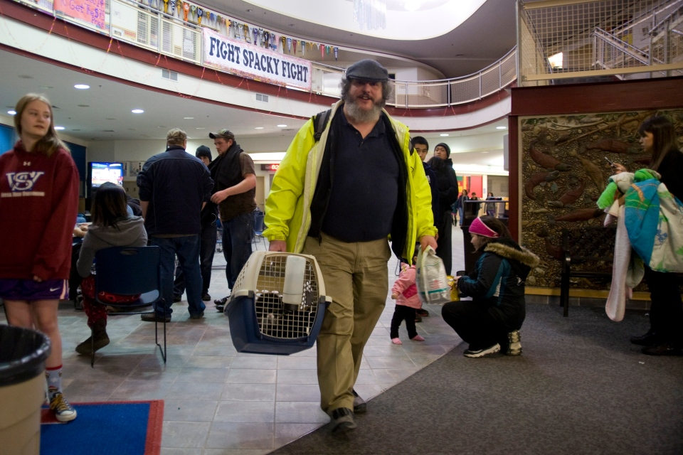 Charles Bingham heads back home with his cats after a tsunami warning was cancelled early Saturday, Jan. 5, 2013, in Sitka, Alaska. (Daily Sitka Sentinel, James Poulson)