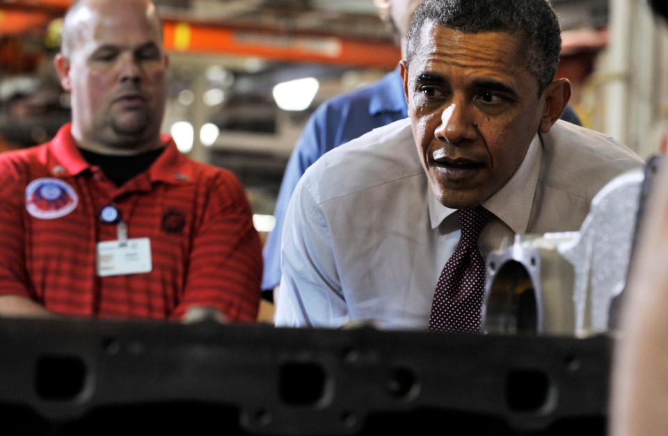 U.S. President Barack Obama takes a look at the piston installation area before he speaks at Detroit Diesel in Redford, Mich. on Monday, Dec. 10, 2012. (The Detroit News, Robin Buckson)