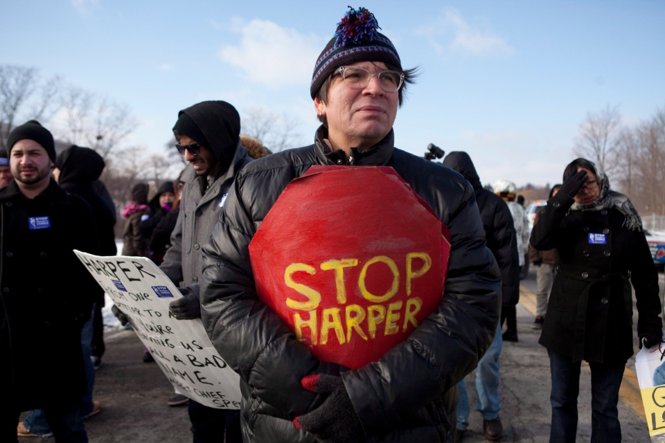 Idle No More activists protest outside of the Ford plant where Prime Minister Stephen Harper was making an announcement, in Oakville, Ont., on Friday, Jan. 4, 2013. (Matthew Sherwood / THE CANADIAN PRESS)