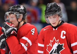 Canada captain Ryan Nugent-Hopkins, right, looks down next to teammate Morgan Rielly, left, after losing to Russia during overtime bronze medal hockey action at the IIHF World Junior Championships in Ufa, Russia, on Saturday, Jan. 5, 2013. (Nathan Denette / THE CANADIAN PRESS)