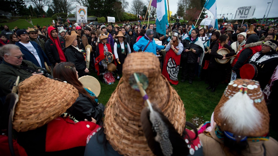 First Nations Idle No More protesters gather at the Douglas-Peace Arch crossing on the Canada-U.S. border near Surrey, B.C., on Saturday, Jan. 5, 2013. (Darryl Dyck / THE CANADIAN PRESS)