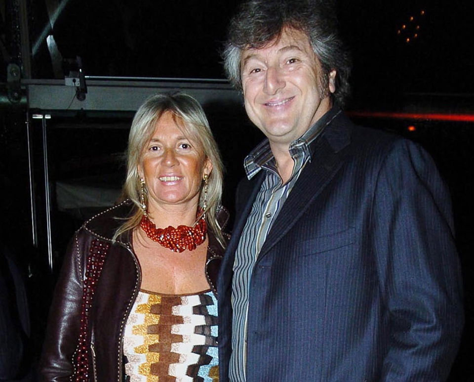 Vittorio Missoni, right, and his wife Maurizia Castiglioni smile in Milan, Italy, March 30, 2005. (Livio Valerio, Lapresse)