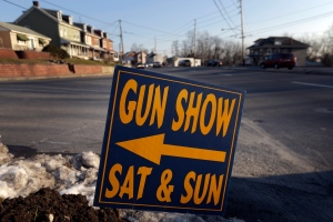 A sign is posted in Leesport, Pa., for an upcoming gun show, Jan. 4, 2013. (AP /Matt Rourke)