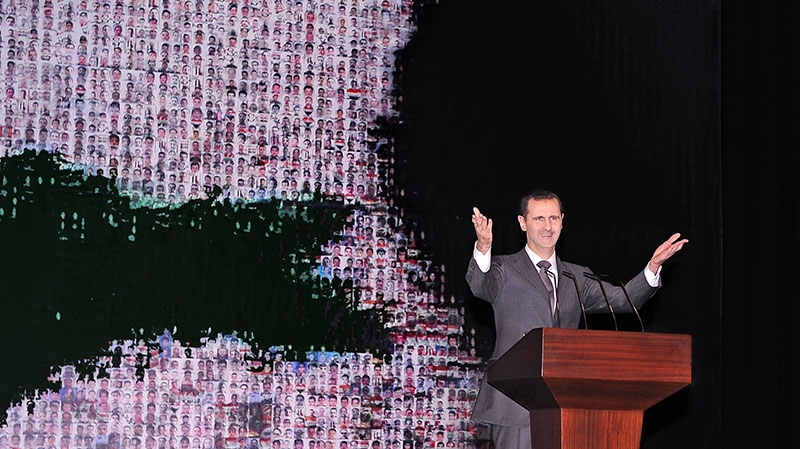 Syrian President Bashar Assad speaks at the Opera House in central Damascus, Syria, Sunday, Jan. 6, 2013. (SANA)