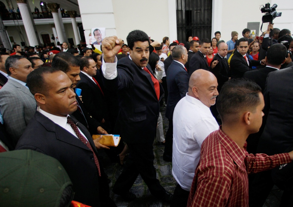 Vice President Nicolas Maduro, centre, gestures to supporters of President Hugo Chavez in Caracas, Venezuela, Saturday, Jan. 5, 2013. (AP / Fernando Llano)