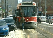 Snowbanks and parked cars are giving TTC streetcar drivers major headaches in Toronto on Monday, March 10, 2008.