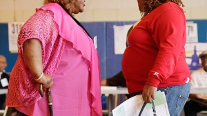 New research suggests that it is not just being obese that increases the risk of heart disease, but also how long someone is obese for. (AP / Mark Lennihan)