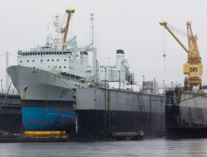 The navy supply ship HMCS Preserver sits at dry dock while undergoing refit in Halifax in this July 2010 file photo. A new model of supply ship has been chosen to replace the aging fleet. (Andrew Vaughan / THE CANADIAN PRESS)