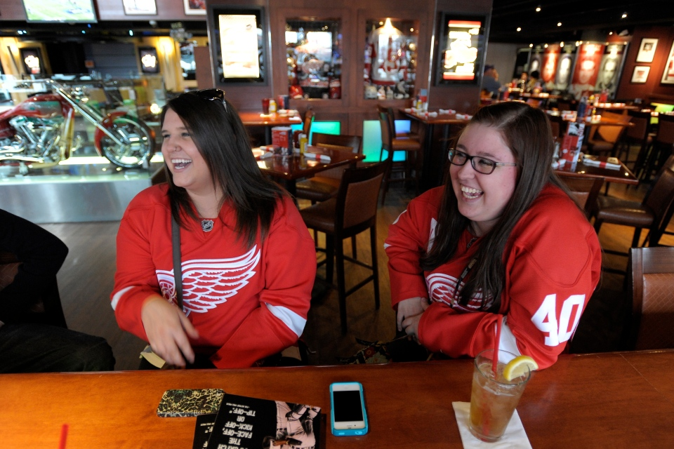 Detroit Red Wings fans Katie Miller, left, of Toledo, Ohio, and Emily Radwanski, of Roseville, Mich., wear their Red Wings jerseys while hanging out at the Hockeytown Cafe in Detroit, Sunday, Jan. 6, 2013. (AP / The Detroit News, David Guralnick)