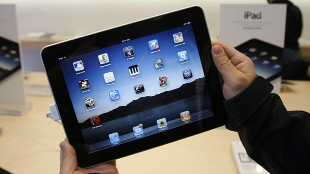 A customer uses an Apple iPad on the first day of Apple iPad sales at an Apple store in San Francisco, April 3, 2010. (AP / Paul Sakuma)