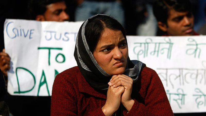 An India woman participates in a protest against the recent gang rape of a young woman in moving bus, in New Delhi, India, Monday, Jan. 7, 2013. (AP / Tsering Topgyal)