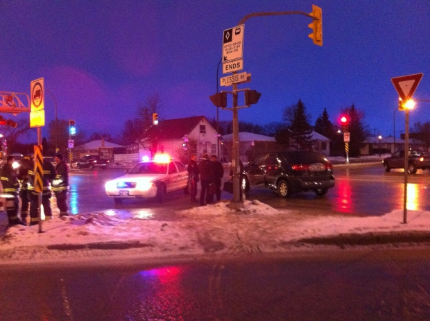 Crews clean up a crash at Plessis and Regent.