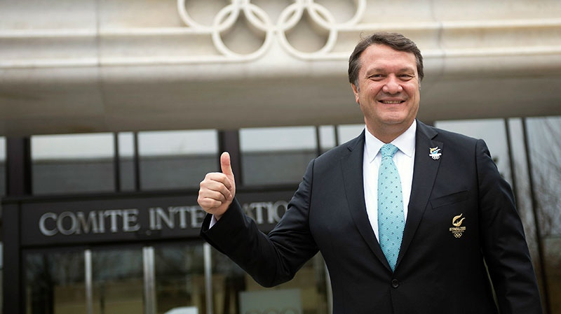 Hasan Arat, Istanbul 2020 Bid Chairman and the Vice President of the Turkish National Olympic Committee, poses for photographers in front of the IOC headquarters before they submit their candidature bid for 2020 Istanbul Olympic summer games at the International Olympic Committee, IOC, headquarters in Lausanne, Switzerland, Monday, Jan. 7, 2013. (Keystone, Jean-Christophe Bott)