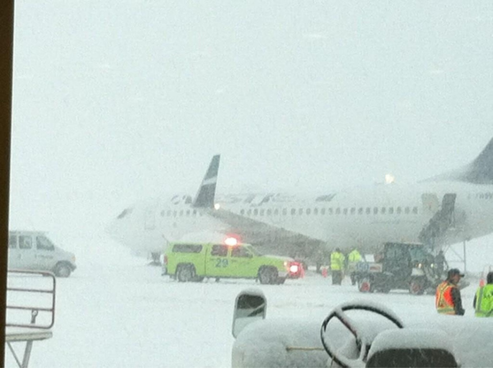 A WestJet flight bound for Edmonton was cancelled after the plane slid off the tarmac on Jan. 7, 2012. (Twitter)