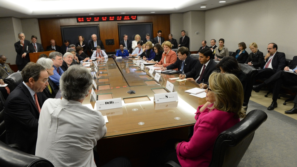 U.S. Secretary of State Hillary Rodham Clinton, right, participates in a meeting of the Assistant Secretaries of State, Monday, Jan. 7, 2013, at the State Department in Washington. (State Department)