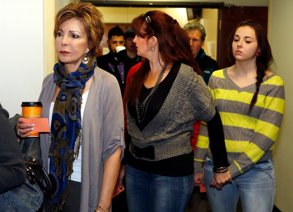 Family members and victims line up to get into court for a preliminary hearing for Aurora theater shooting suspect James Holmes at the courthouse in Centennial, Colo., on Monday, Jan. 7, 2013. (AP / Ed Andrieski)