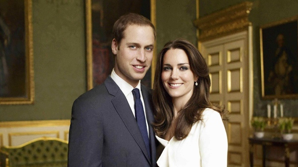 This is one of two official portrait photographs taken in the Council Chamber in the State Apartment in St James's Palace, London and released by Clarence House Press Office on Sunday Dec. 12, 2010 to mark the engagement of Britain's Prince William, left, and Catherine Middleton, right. (Clarence House Press Office / Copyright 2010 Mario Testino)