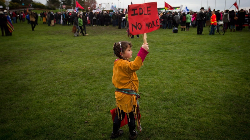Four-year-old Lily Mervyn, whose mother is Metis and father is of Cherokee heritage, holds a sign while attending a First Nations Idle No More demonstration with her family at the Douglas-Peace Arch crossing on the Canada-U.S. border near Surrey, B.C., on Saturday, Jan. 5, 2013. (Darryl Dyck / THE CANADIAN PRESS)