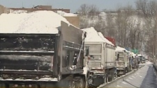 As the city cleans up, trucks carry snow to depots around Montreal on Monday, March 10, 2008.