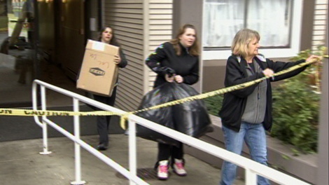 Residents retrieve personal possessions from their apartment after a deadly fire. Dec. 13, 2010. (CTV)