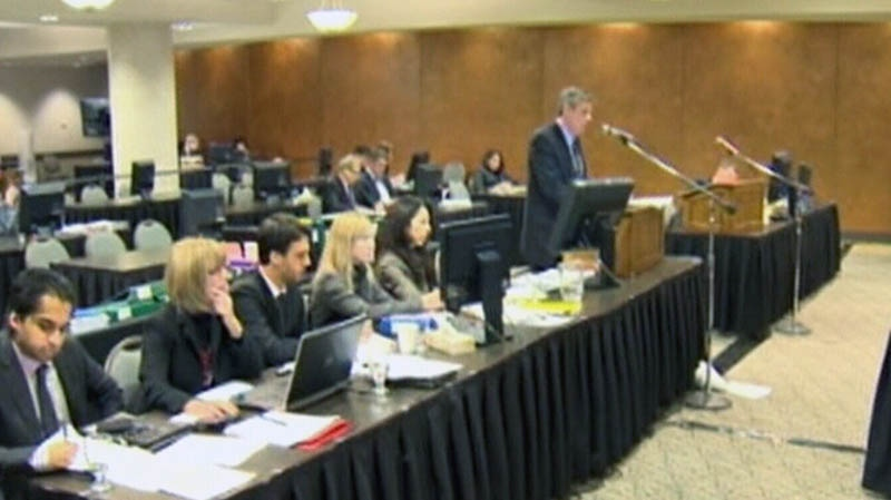 This image taken from video shows a panel investigating the death of 5-year-old Phoenix Sinclair, in December 2012.