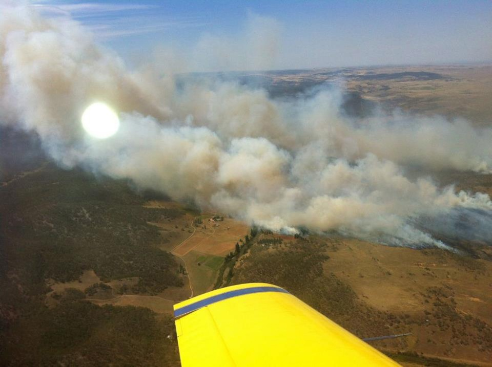 In this photo provided by the New South Wales Rural Fire Service, plumes of smoke rise from a fire near Cooma, Australia, Tuesday, Jan. 8, 2013. (AP Photo / New South Wales Rural Fire Services)