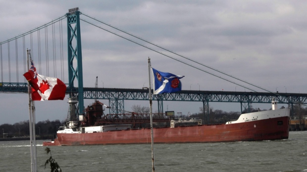 The Ambassador Bridge at the Windsor-Detroit international crossing is pictured as a ship navigates by on 'Black Friday' from Windsor, Ont., Friday, Nov., 26, 2010. (Brent Foster / THE CANADIAN PRESS)