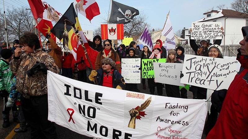 Aboriginal protesters and supporters in the Idle No More movement march on their way to blocking the Blue Water Bridge to the United States in Sarnia, Ont. on Saturday, Jan. 5, 2013. (Dave Chidley / THE CANADIAN PRESS)