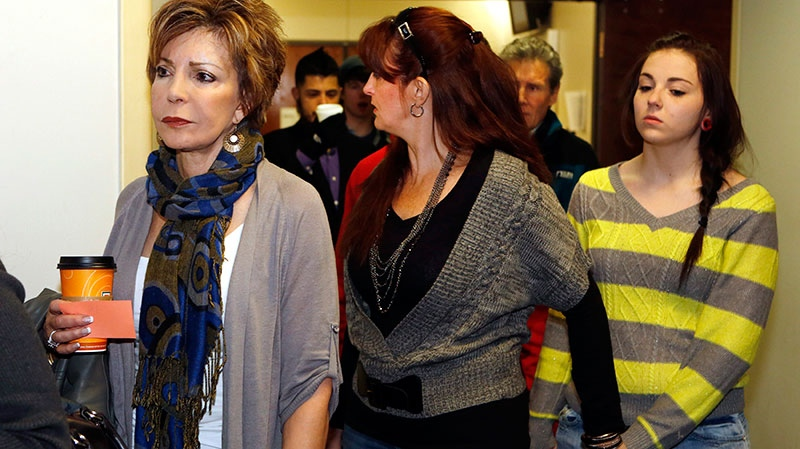 Family members and victims line up to get into court for a preliminary hearing for Aurora theater shooting suspect james Holmes at the courthouse in Centennial, Colo., Monday, Jan. 7, 2013. (AP / Ed Andrieski)