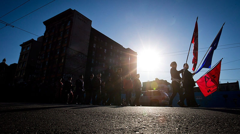 Veterans march through the Downtown Eastside to a National Aboriginal Veterans Day ceremony at the Victory Square Cenotaph in Vancouver, B.C., on Thursday, Nov. 8, 2012. (Darryl Dyck / THE CANADIAN PRESS)